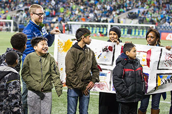 Yesler kids attend Sounders game
