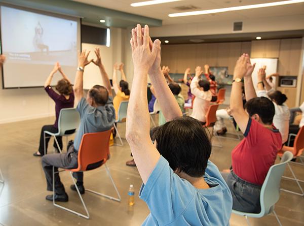 people doing chair yoga