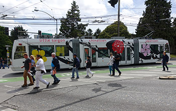 People walking as streetcar passes