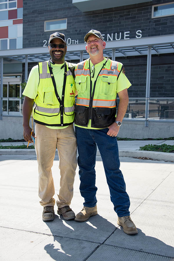 Two construction workers standing