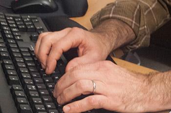 hands at computer