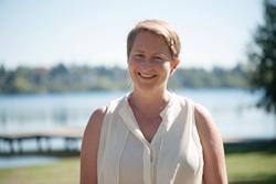 Elizabeth standing by a lake