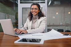 woman at computer assisting someone
