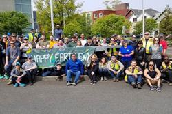 Earth Day volunteers holding banner