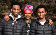 Woman standing with two teenage boys