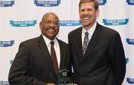 Andrew Lofton holds Friend of Housing Award