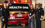 Health One Unit officials standing by vehicle