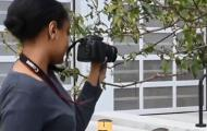 Young filmmaker holding camera