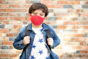 Boy with face covering