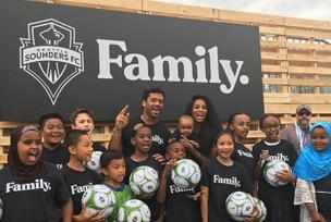 Russell Wilson, Ciara and yesler youth at Sounders celebration