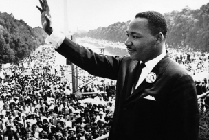 Martin Luther King Jr. waving at crowds during the 1963 Civil Rights March in Washington D.C.