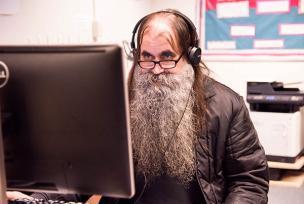 Elder man on computer