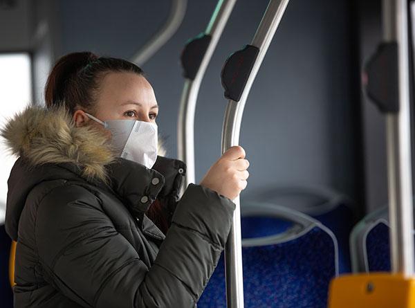 Woman on public transit wearing mask